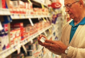 corbis_rm_photo_of_senior_selecting_otc_medicine