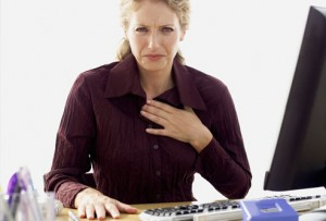 getty_rf_photo_ofwoman_with_heartburn_at_work