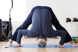 photolibrary_rf_photo_of_man_doing_yoga