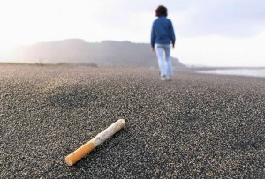 photolibrary_rm_photo_of_woman_walking_away_from_cigarette