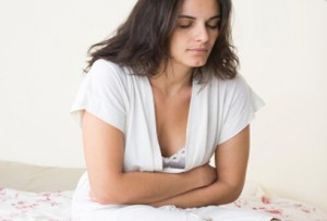15-cancer-symptoms-women-s3-woman-with-bloating